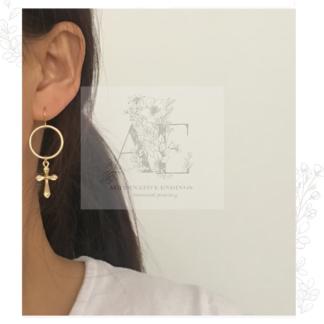 Gold Cross Hoop Earring worn by model