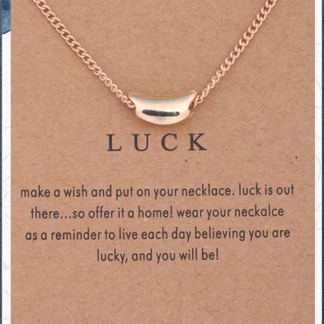 Gold Luck Necklace on a card