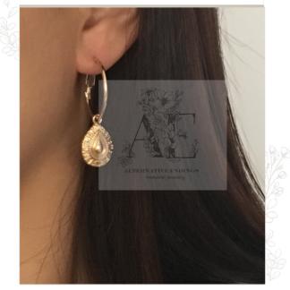 Gold Textured Water Drop Hoop Earring worn by model