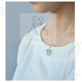 Sterling Silver Magnolia Flower Necklace on model