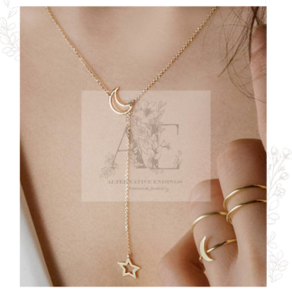 Gold Moon and Shooting Star Necklace worn by model