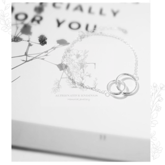 Sterling Silver Infinity Bracelet on card with words