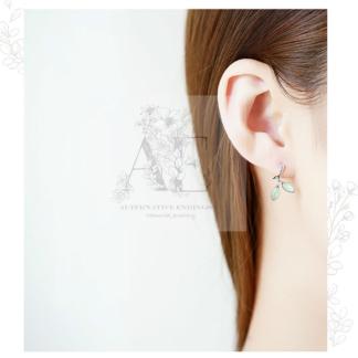 Sterling Silver Green Leaf Earring worn by model